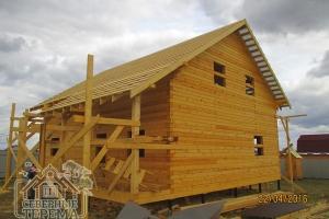 Дом из профилированного бруса 10х10 с угловой террасой под усадку