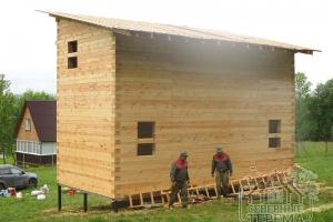 Дом из бруса, построенный компанией
