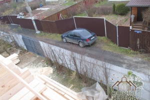 Вид на проезжую часть с высоты 2 этажа дома на участке Заказчика