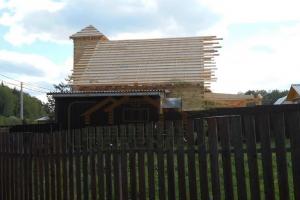 Дом с башней и кукушками из бруса
