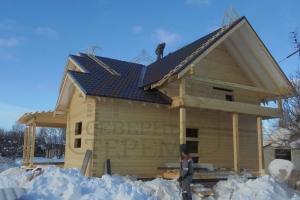 Дом с террасой и балконом из профилированного бруса