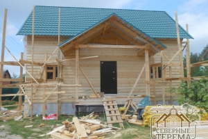 Отделка крыльца и фасада брусового дома