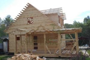 Брусовой дом с мансардой и террасой
