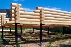 Деревянный дом на свайно-винтовом фундаменте