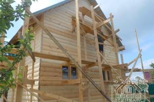 Отделка дома из профилированного бруса деревянным сайдингом