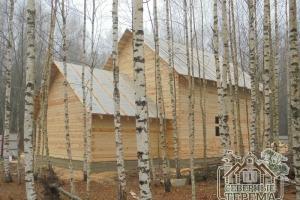 Деревянный дом из профилированного бруса под усадку